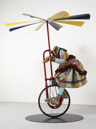 Girl on Flying Machine, Yinka Shonibare MBE, 2008. Image © the artist and courtesy of the artist and Stephen Friedman Gallery, London and James Cohan Gallery, New York